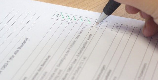 a person ticking items on a checklist