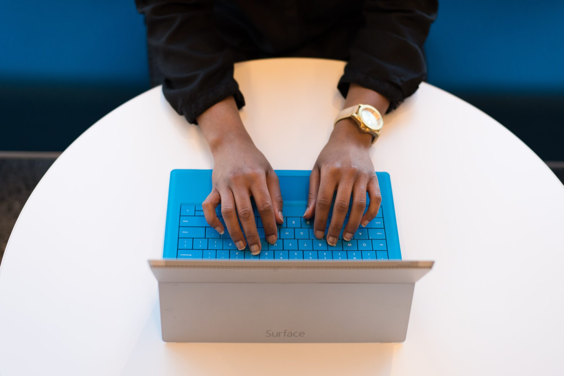 a person using a property management software for landlords on a blue laptop